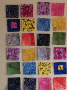 Fabric squares on design wall.