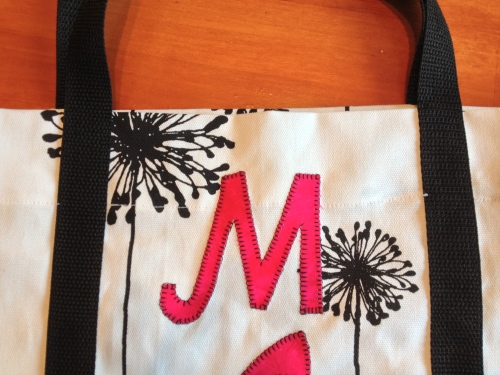 Blanket stitch letters. Could satin stitch or straight stitch instead.