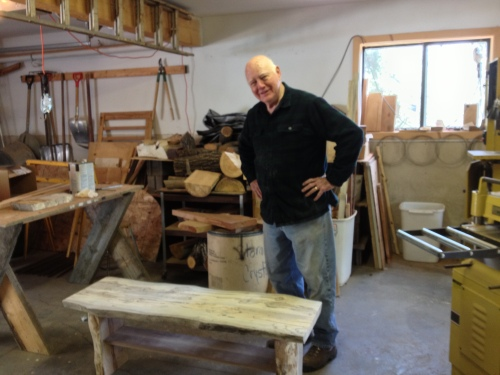This is JB with a bench that he made the week before which will be sold in a local gallery when he finishes it.