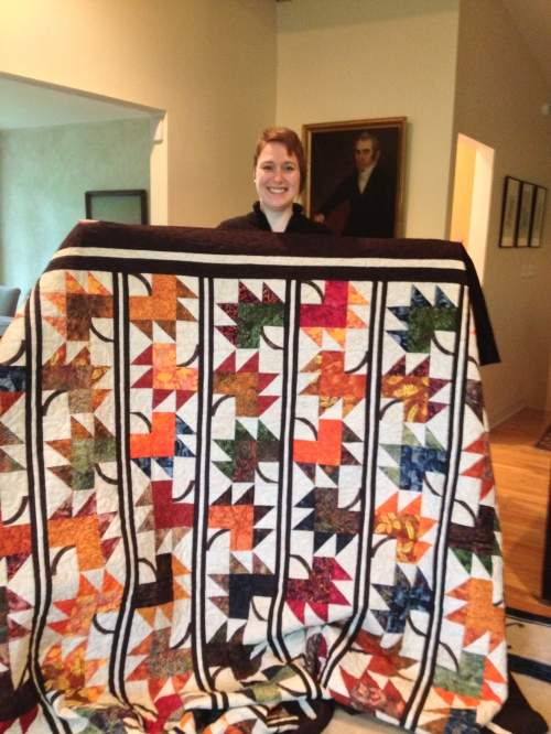 Lindsey shows off her finished quilt - which she just finished binding.