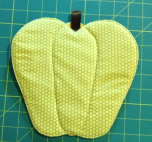Back of pepper hot pad.