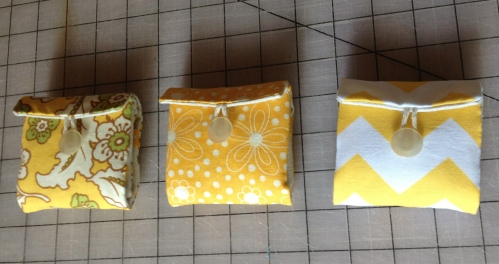 Teabags places within pockets and pouch folded up and button sewn in place.