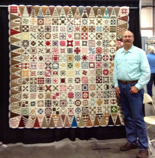Jim with the quilt made by Goldie Morrow.