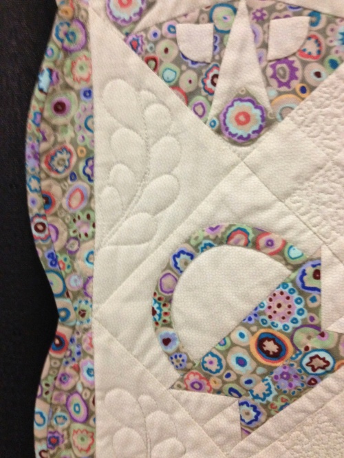 Close-up shows a bright Kaffe Fassett print and lovely scalloped border.