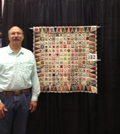 Jim shows how small this quilt is.