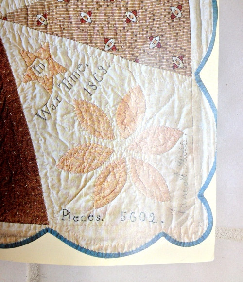 "Label from Jane's quilt.  ""In War Time.  1868.  Pieces 5602 Jane A. Stickle"""