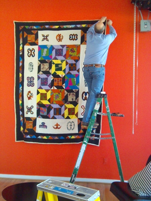 My husband hanging the largest quilt in the exhibit.