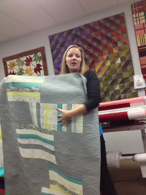Angela showing one of her quilts.